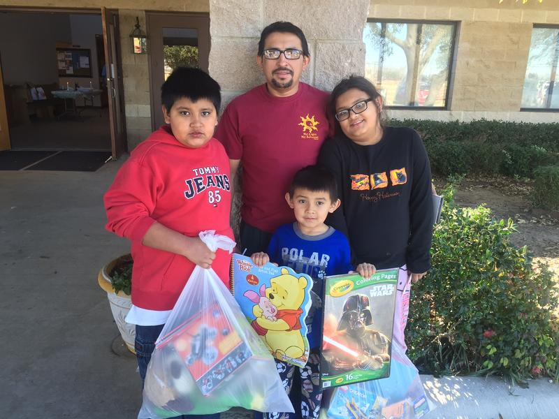 The Majano family lost nearly everything in the Dec. 26 tornado. Over the weekend, dad Edwin Majano took his children to an event for families affected by the storm. From left: Erlin, 11; Edwin; Sandra, 10 and Esteban, 6.