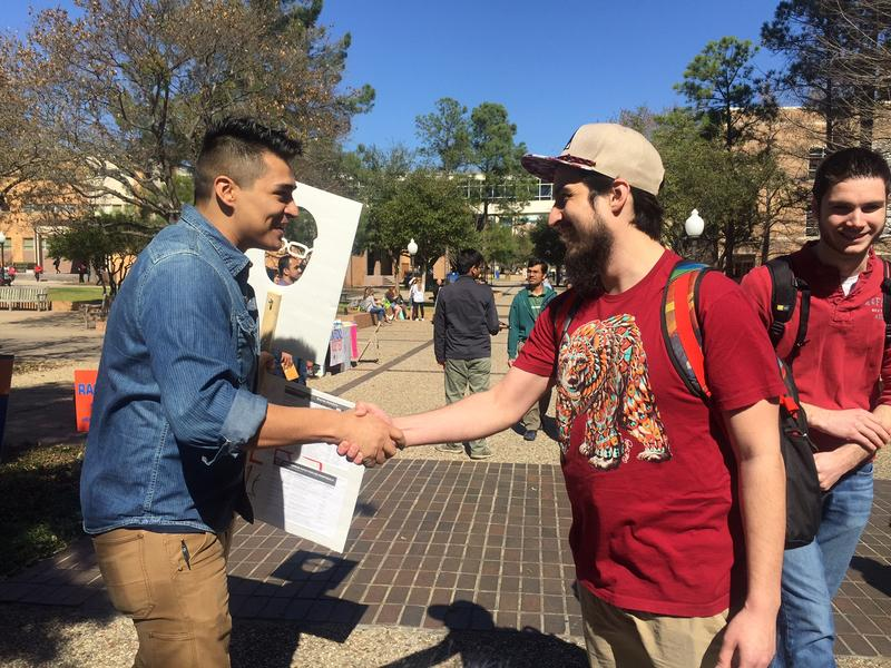 Ramon Hernandez, a University of Texas at Arlington student, talks to other students about voting for Democratic presidential candidate Bernie Sanders.