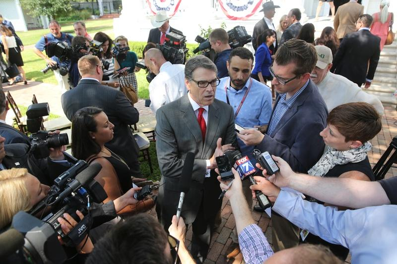 Former Gov. Rick Perry spoke to reporters at the Governor's Mansion in August.
