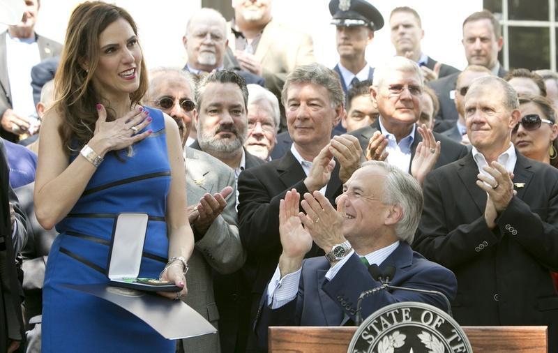 Taya Kyle receives the Texas Legislative Medal of Honor that Gov. Greg Abbott awarded to her late husband, Chris Kyle, in August.
