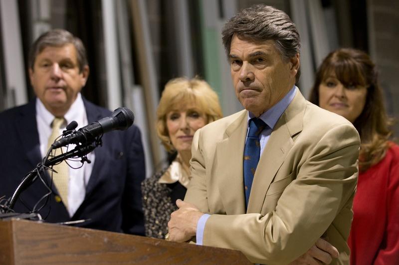 Texas Gov. Rick Perry and Lt. Gov. David Dewhurst hold a press conference on proposed legislation regarding drug testing for state benefit recipients on Nov. 13, 2012