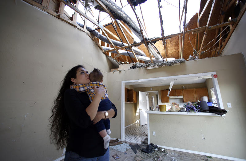 Lindsay Diaz and her son, 7-month-old Arian Krasniqi, in the living room of their Rowlett home.