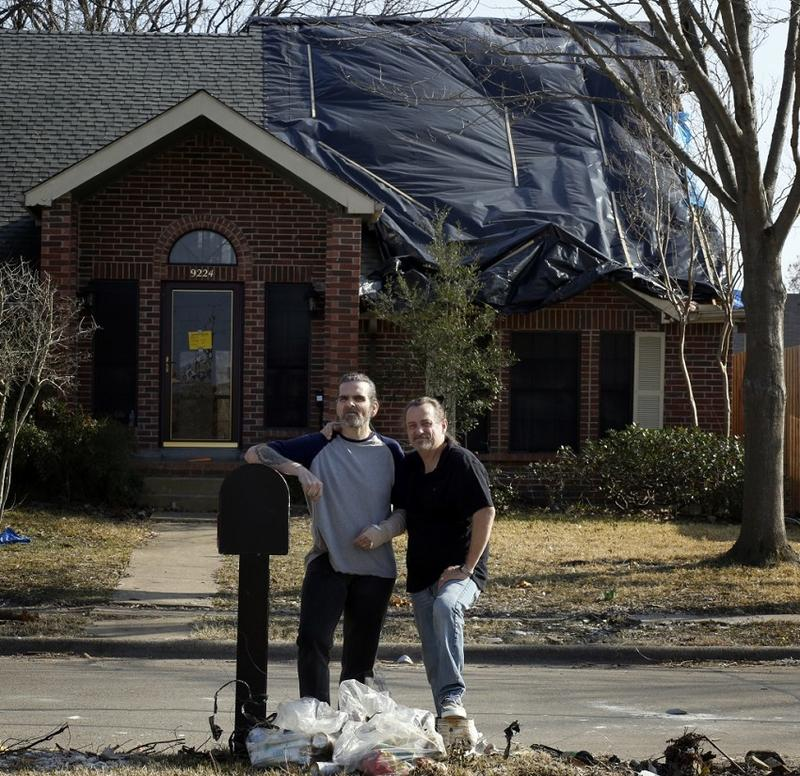 Alfredo and Anthony Fowler-Rainone in front of their house Rowlett.
