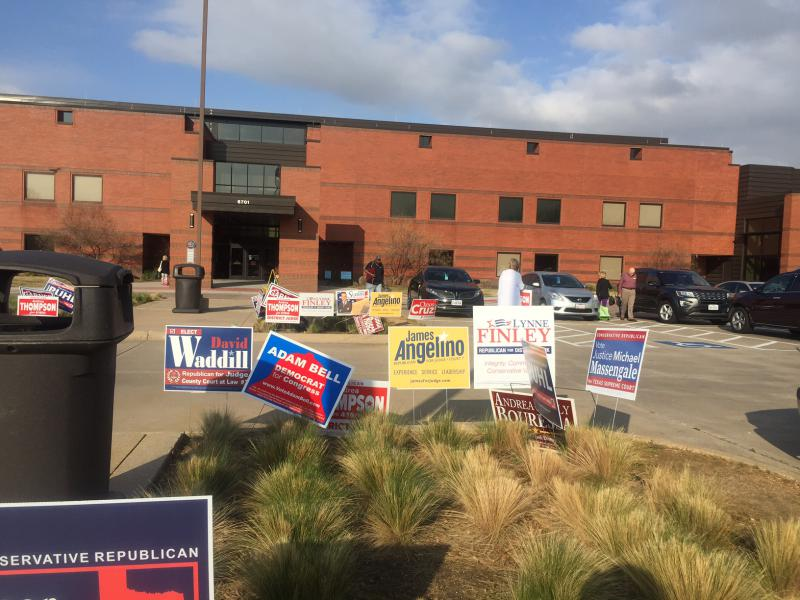 A sea of signs greets voters at Carpenter Park Recreation Center in Plano.