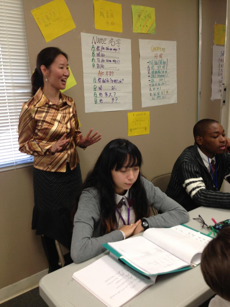 Teacher Shenglin Selinger is a native of China and used to teach in Dallas ISD. She plays songs and shows videos to help students learn Mandarin.