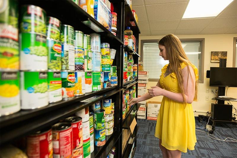 Ashlee Taylor, president of the graduate student advisory council and a Ph.D. student in nutritional sciences at Texas Tech University, organizes the Wreck Hunger graduate and international student food pantry.