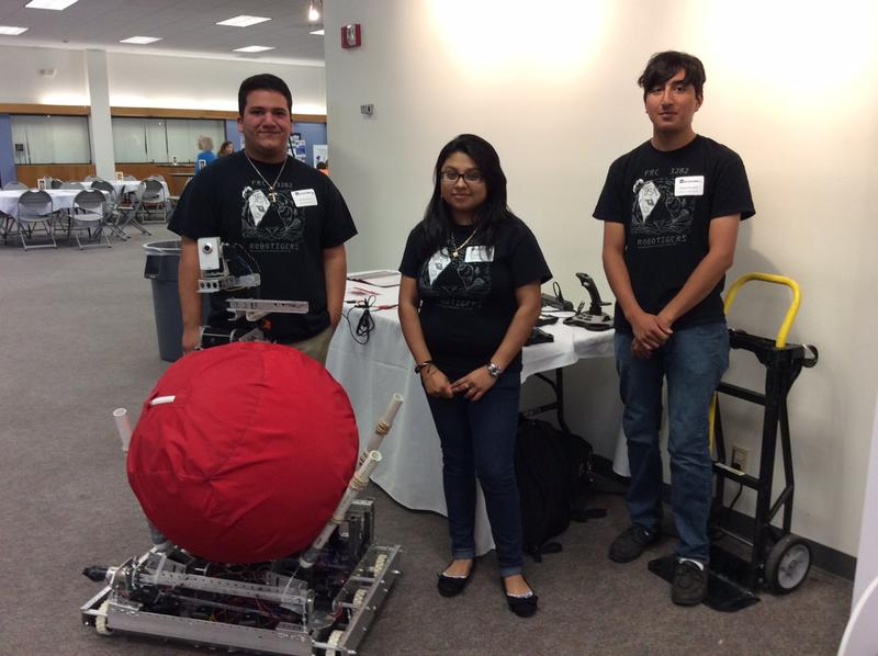 Sergio Esquibel, 19, Maria Peña, 19, and Andres Herrera, 18, attend Harmony Public Schools. At school they're learning how to build robots like this one.
