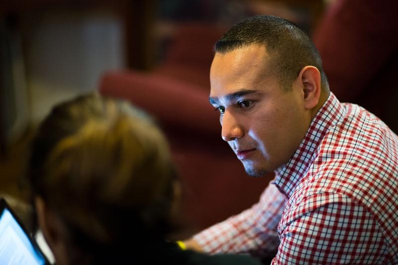 Child Protective Services Investigator Daniel Hernandez interviews family members during a home visit in March.