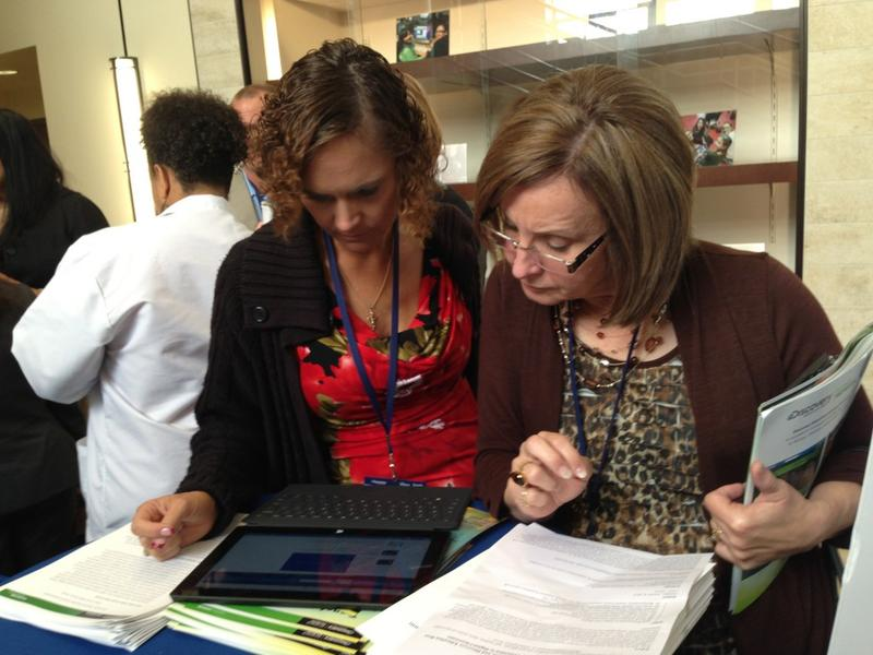 DeAnne Page, who oversees technology in the Lindsay school district near Gainesville, and Superintendent Nora Curry look at lesson plans on a tablet.