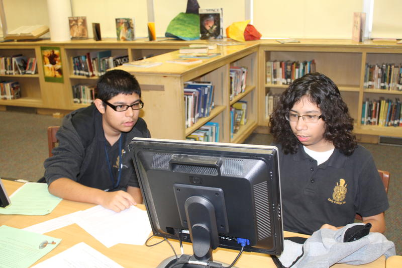 Joel Luera and classmate Abel Hernandez do some research online for their world geography class.