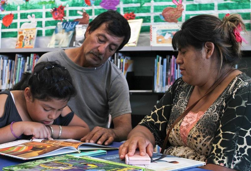 Andrea Ortiz Lara and her family at the North Oak Cliff Library.