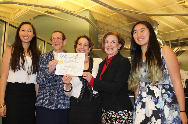 Sarah Goodfriend, second from left, and Suzanne Bryant, center, with their daughters (far left and far right) and Travis County Clerk Dana DeBeauvoir, second from right. DeBeauvoir issued Goodfriend and Bryant a marriage license in February 2015.