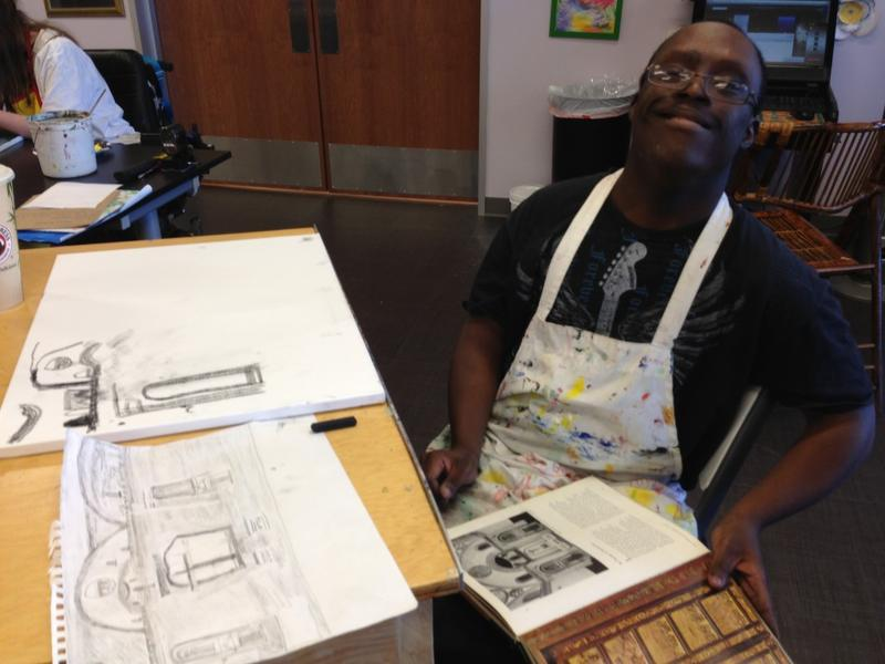 Allen Mitchell, 22, is working on a sketch of a chapel he saw in an art book.