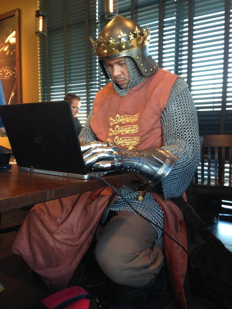 Online history teacher Heath Hamrick catches up on grading and blogging while working out of a local Starbucks. He says he's been asked more questions about teaching online than he has about his costume.