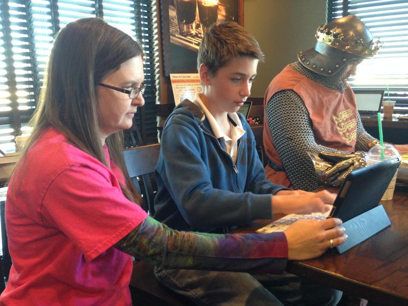 Language arts teacher Jessica Lee works with student Hudson Brown at an area Starbucks. Lee has been in education 15 years and was looking for something different when she took the job.