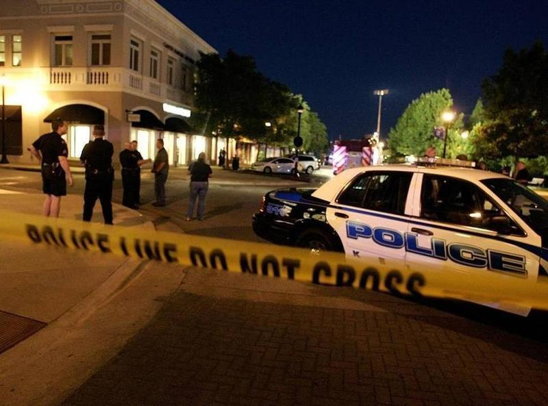 Police in 2013 investigate the scene at the Southlake Town Square where lawyer Juan Jesus Guerrero Chapa was killed.