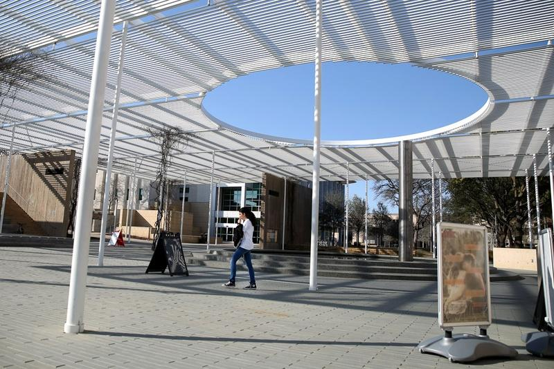 A student walks through a newly constructed pavilion on the campus of the University of Texas at Dallas. UT-Dallas has invested more than $1 billion on construction in the past decade.