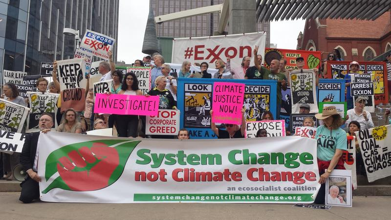 Environmentalists protested outside the ExxonMobil annual shareholders meeting in Dallas over the oil company's position on climate change.