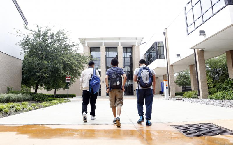 Students walk into W.W. Samuel Early College High School in Dallas, May 2016.