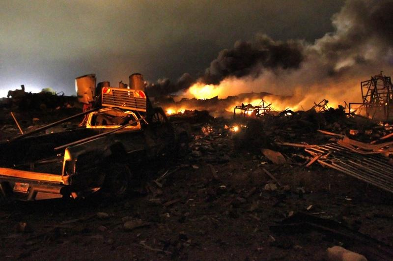 A vehicle near the remains of a fertilizer plant burning after an explosion in West, Texas.