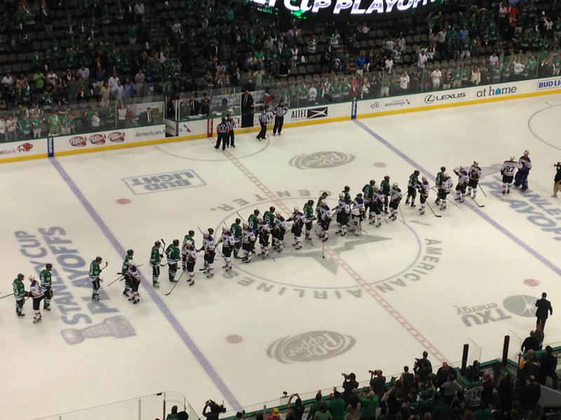Stars and Blues players line up in the traditional hand shake at the end of the game. It was game 7 of the series in the second round of the Stanley Cup playoffs.