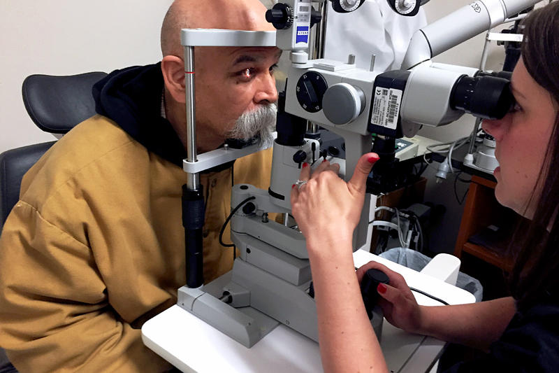 Joe Hernandez gets a post-op eye exam after his cataract surgery. He has perfect vision now in an eye that was only able to register light and shadow before.