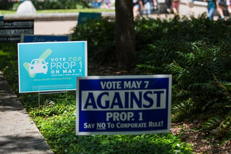 Austin's Prop 1 signs posted along the University of Texas campus voting center on April 28, 2016.