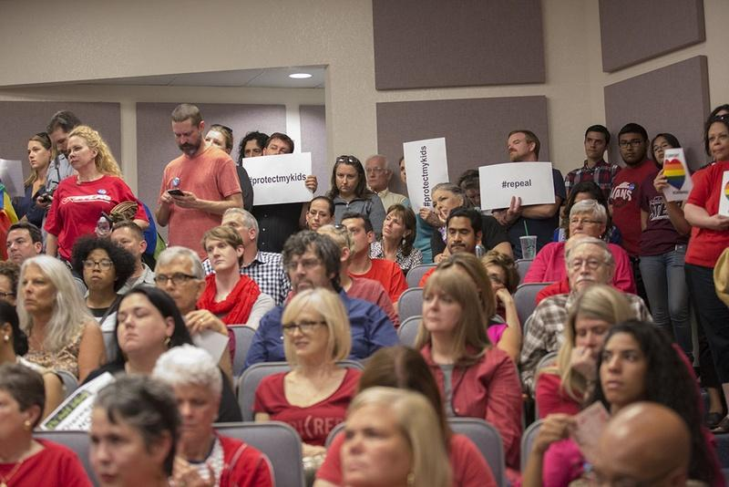 Opponents and supporters of the Fort Worth Independent School District's guidelines for transgender children pack a school board meeting on May 10.