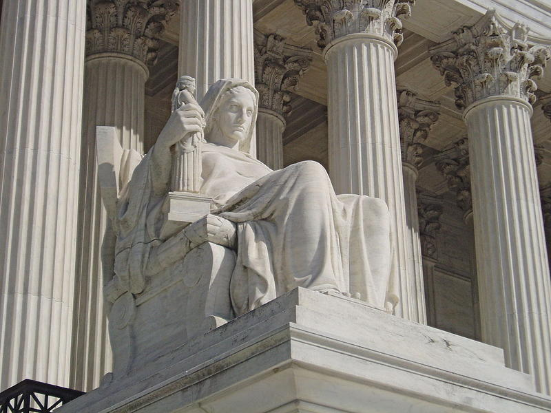 James Earle Fraser's statue The Contemplation of Justice, which sits on the west side of the United States Supreme Court building, on the north side of the main entrance stairs.