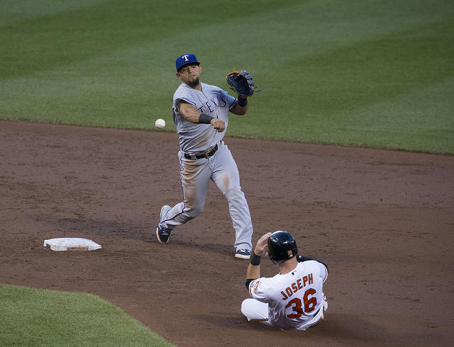 Second baseman Rougned Odor tries to turn a double play against the Baltimore Orioles.