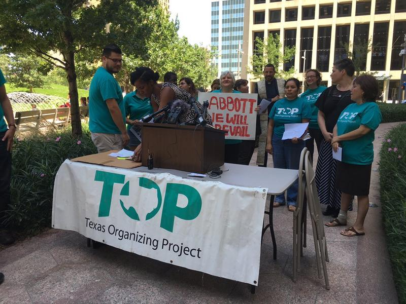 Texas Organizing Project sets up for a press conference following the U.S. Supreme Court's immigration ruling.