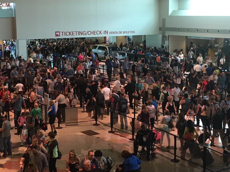 People waiting in security lines at Dallas Love Field.