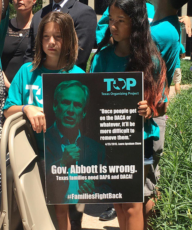 Two young girls holding this sign at the Texas Organizing Project press conference Thursday afternoon.