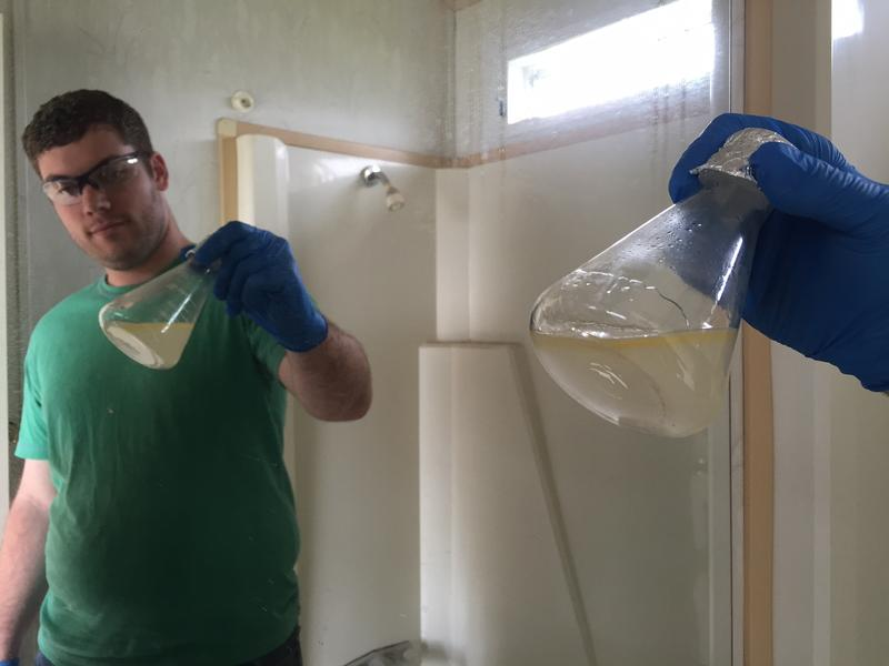 UNT Ph.D. candidate Ethan McBride prepares the precursor to the illegal drug PCP in a trailer.