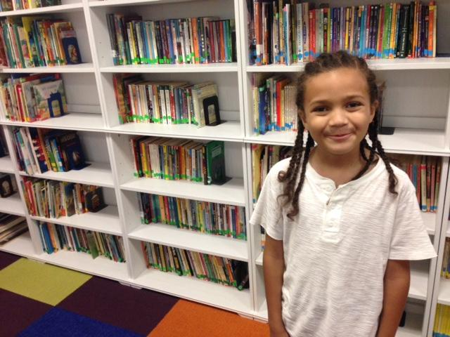 Jatari Malcolm, 7, went from reading two grade levels behind to right on grade level in a single year.