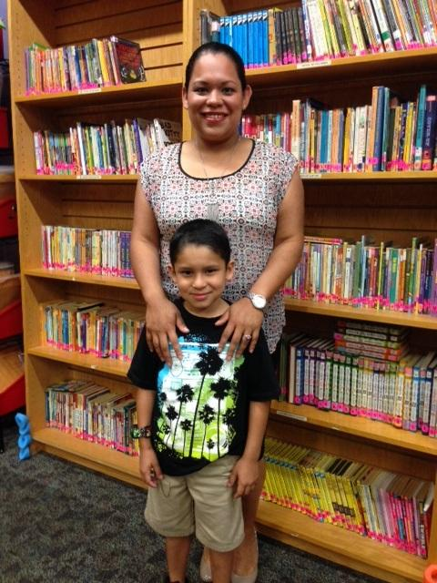 Jessica Suarez and  her son Jayden Barrera in the library at camp.