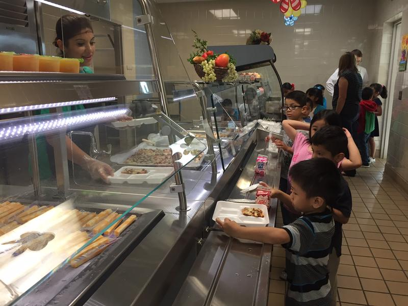 Students line up for breakfast at Adams Elementary in Arlington. The district is expanding its summer meals program to about 50 locations this year.