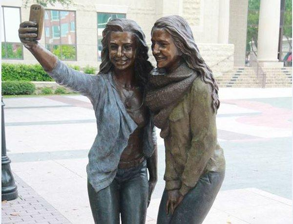 """Selfie"", a bronze statue recently erected in Sugar Land's Town Square."