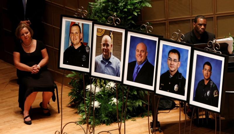 Photos of the five fallen officers were displayed on stage at an interfaith memorial service in Dallas on Tuesday.