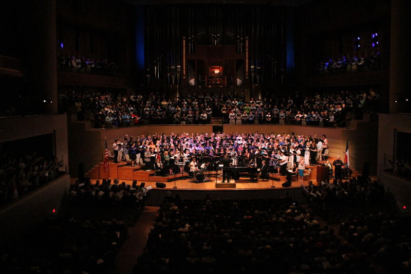 Hundreds of singers join conductor Jonathan Palant on stage at the Meyerson Thursday night.