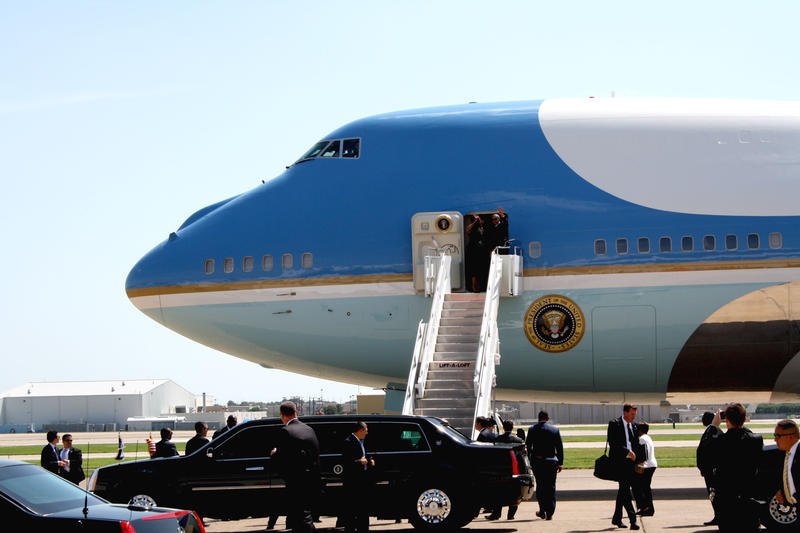 President Obama, with First Lady Michelle Obama, leaving Dallas after attending a memorial service downtown.