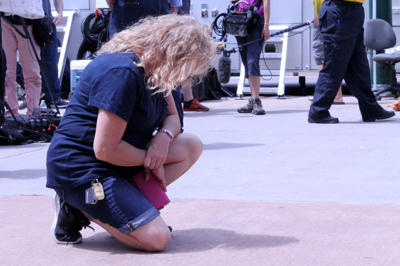 A woman mourns in front of the memorial.