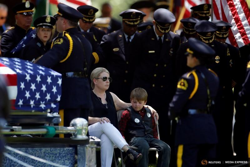 Katrina Ahrens sat with her son, Magnus, during the funeral of her husband, Lorne Ahrens. He was one of the five officers killed during last week's ambush in downtown Dallas.
