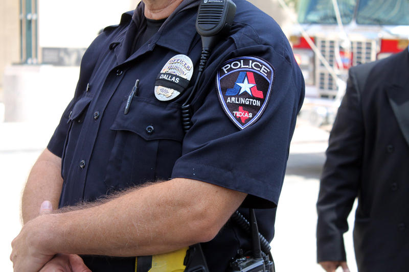An Arlington police officer stood outside the barricade in front of the Meyerson.