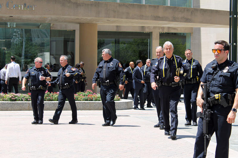Several police officers exited the Meyerson after the memorial service Tuesday.