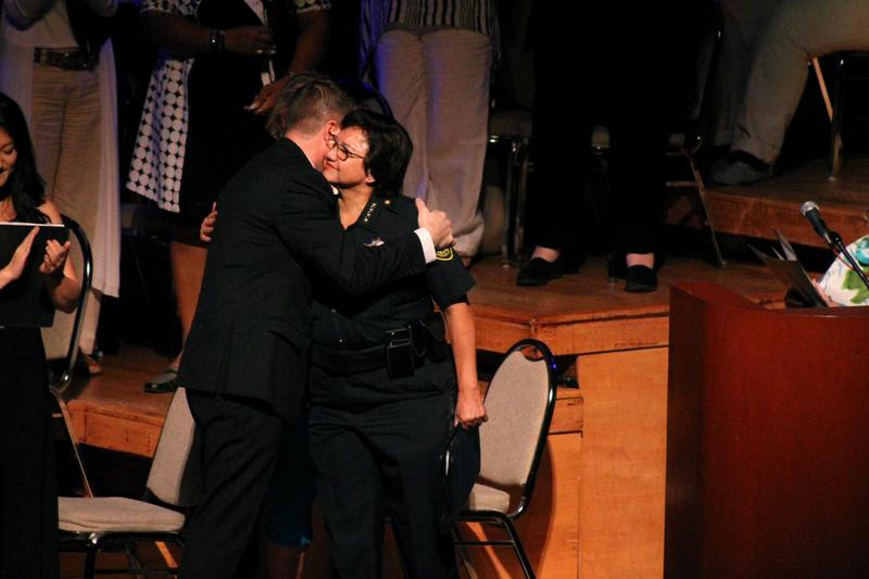 Dallas County Sheriff Lupe Valdez hugs conductor Jonathan Palant.
