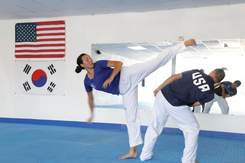 Jackie Galloway trains works out with younger brother Austin, who is her official Olympic training partner.