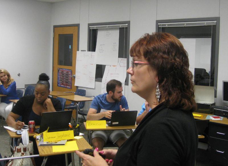 IB coordinator Kari Christensen tells her IB teacher-students the importance of 'process journals.'
