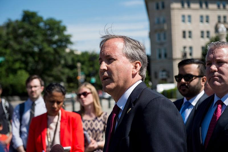 Texas Attorney General Ken Paxton holds a press conference on June 9, 2016 in front of the U.S. Supreme Court to discuss the filing of a lawsuit against the state of Delaware.