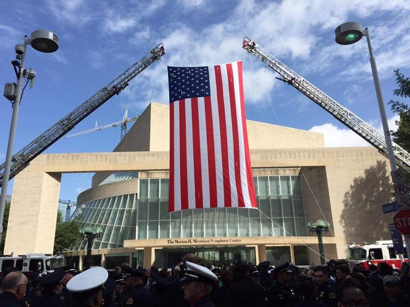 Dallas police officers outside of the Morton H. Meyerson Center in Dallas.